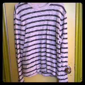 Men's long sleeve, blue striped shirt.